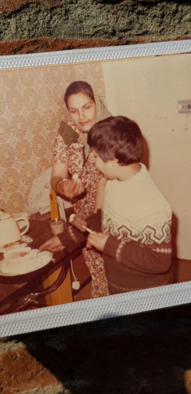 young dadima feeding her son.jpg