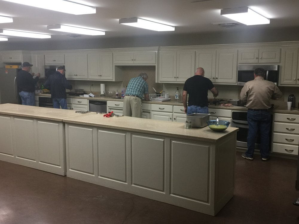 From Right to Left: Wayne Murders cooking scrambled eggs, Billy Abbott cooking bacon, Roger Holder cleaning up and warming hash browns, Russ Norman cooking sausage and Phillip Robbins fixing sausage gravy. Note: The biscuits are donated by Mary and David Bass, The Original Burgers and More.