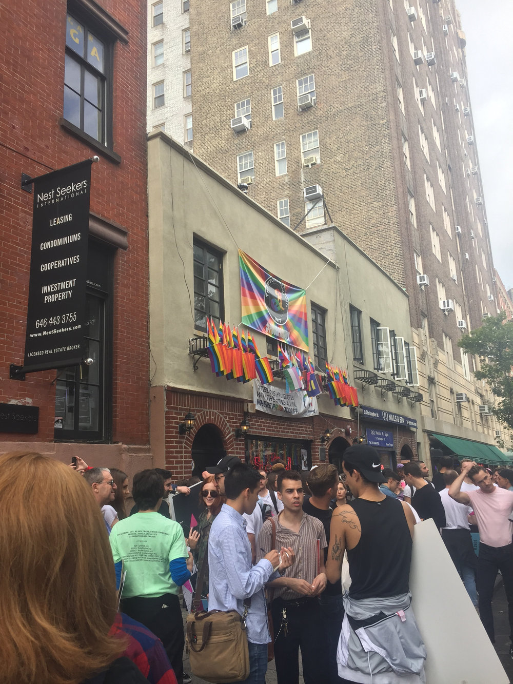 Activists gather outside the Stonewall Inn before the march, New York, NY.