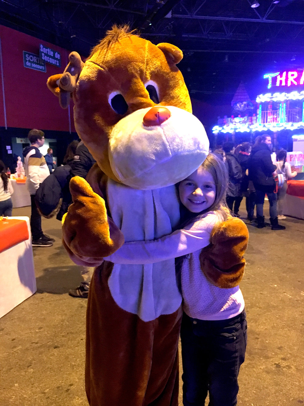 Elma, the young girl from CAES, poses with a costumed worker at the La Fête de Foraine, a fun-fair coordinated by local non-profit organizations. Photo courtesy:  Amy Nakamura .
