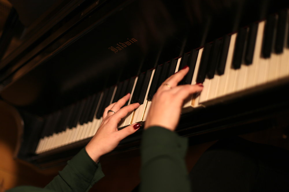 Semaňáková plays a Slovakian folk song on the piano at Belfer Audio Laboratory near Bird Library. She'll be taking a beginner audio recording course this spring as part of her graduate Audio Arts program. Photo by  Jiaman (Maggie) Peng .