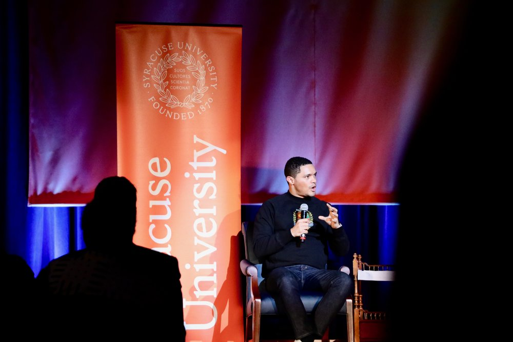 Trevor Noah takes the stage at the Carrier Dome in Syracuse University. The comedian, author, and television host was this year's MLK dinner speaker. Photo by  Saniya More .