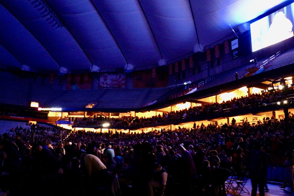 The stadium erupts after the end of a performance. Photo by Saniya More.