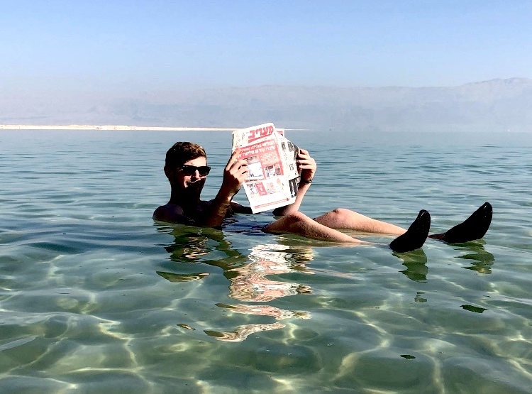 """""""Effortlessly floating"""" in the Dead Sea. Photo courtesy:  Landon Wexle r"""