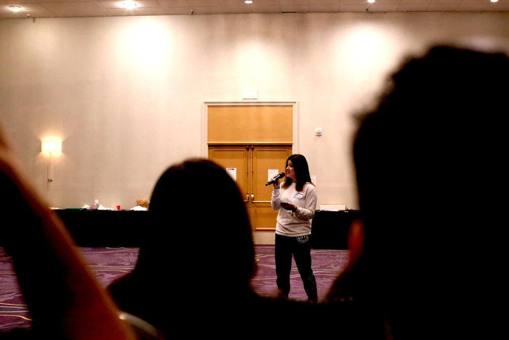 """Diana Quesada performed the song """"Popular"""" from  Wicked  during the 2019 PossePlus Retreat in February in Rochester, NY. Photo by  Jiaman (Maggie) Peng ."""