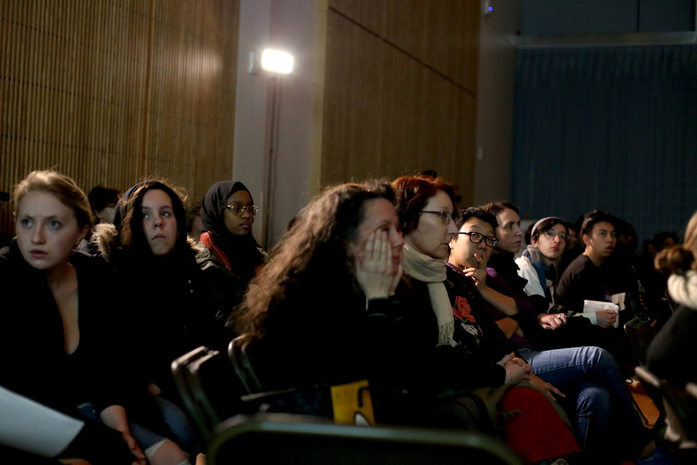 Audience members react to a short film series by an artist on one of the panels at Thursday's symposium on race and justice. Photo by Jiaman (Maggie) Peng.