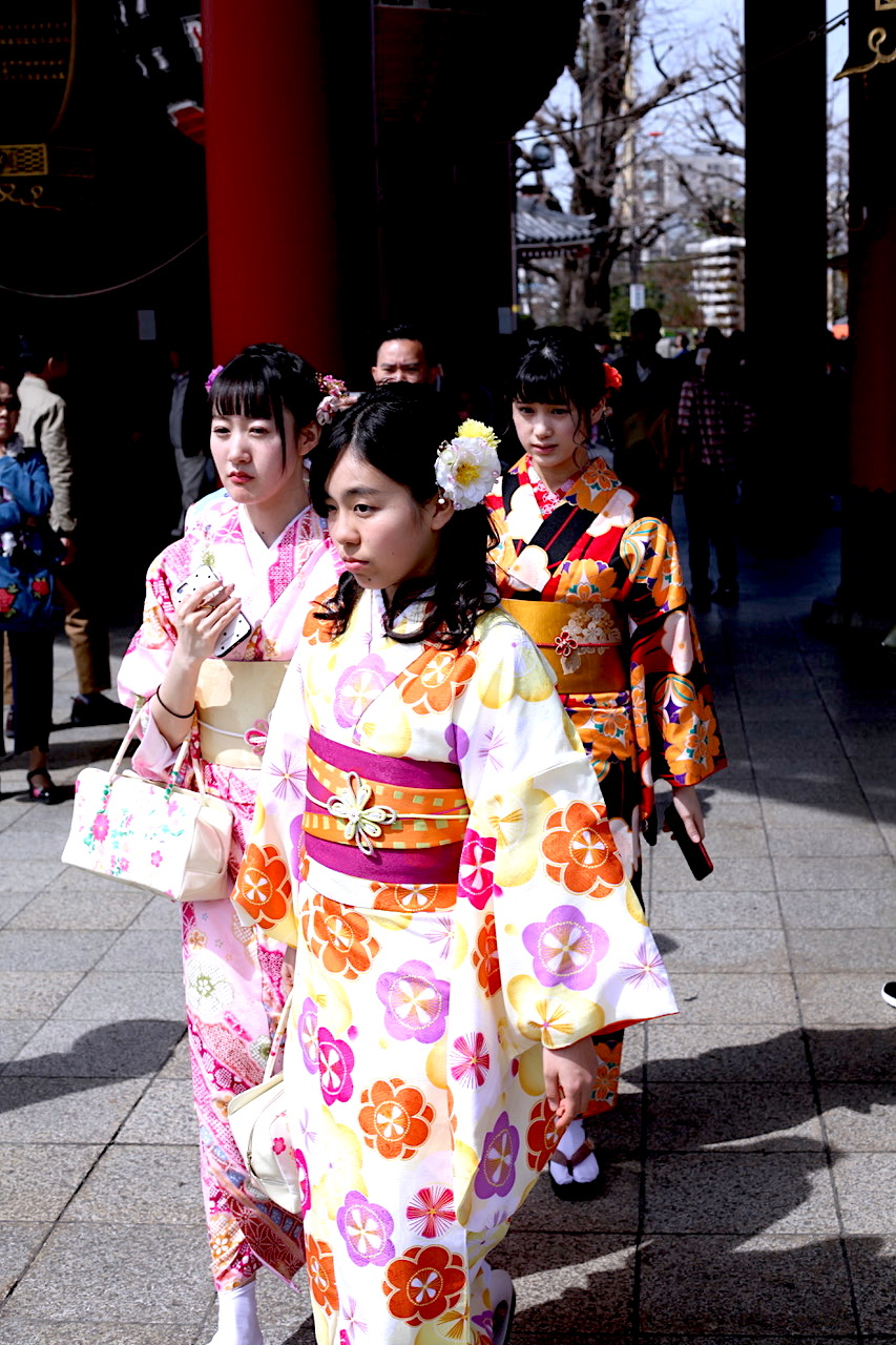 Young girls walk through the markets in Tokyo, Japan. Photo courtesy:  Kuba Wasowicz .