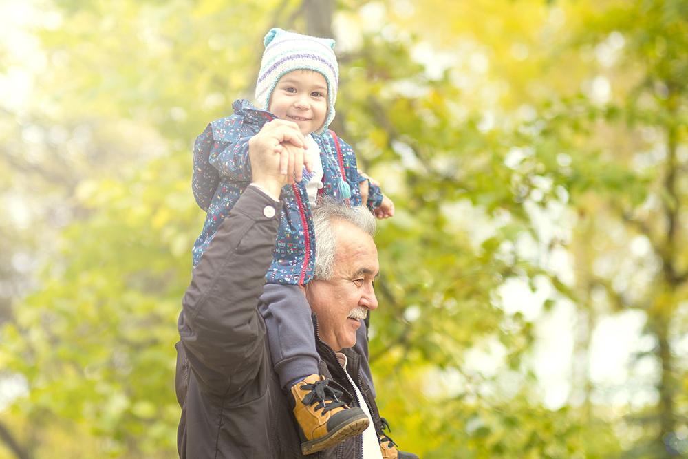 grandpa carrying grandkid