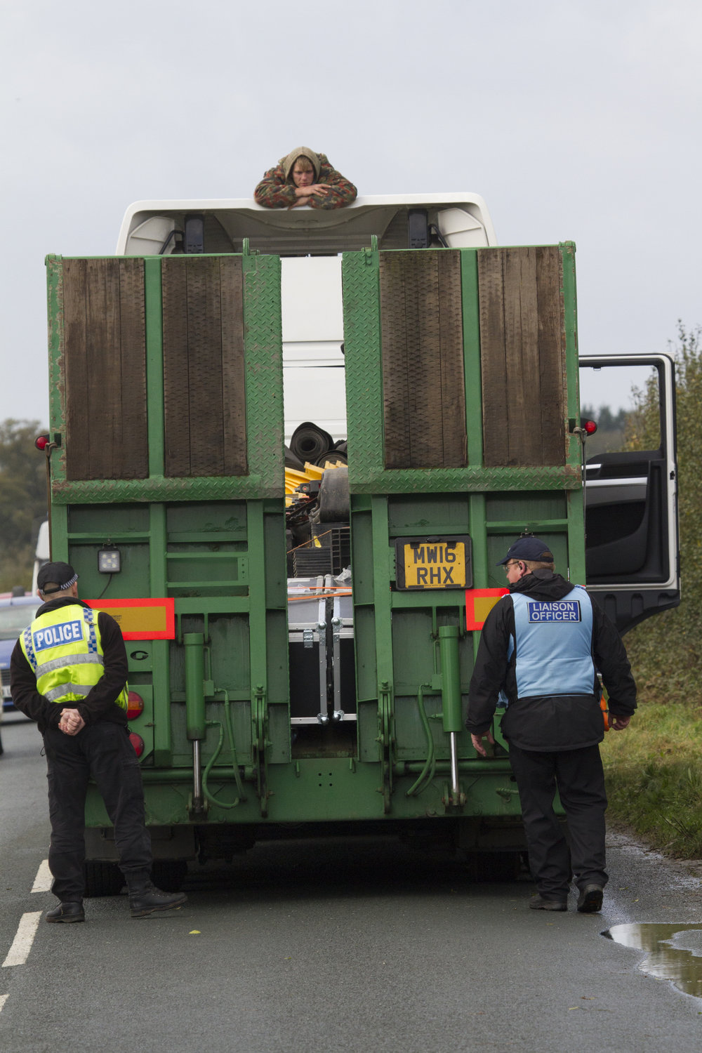 An activist surfs a lorry in Kirby Misperton. Photo courtesy of  Yorkshire's Fracking Frontline