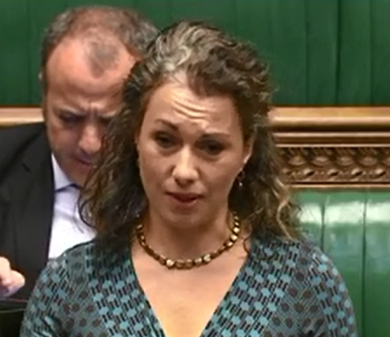 Sarah-Speaking-in-Parliament.png