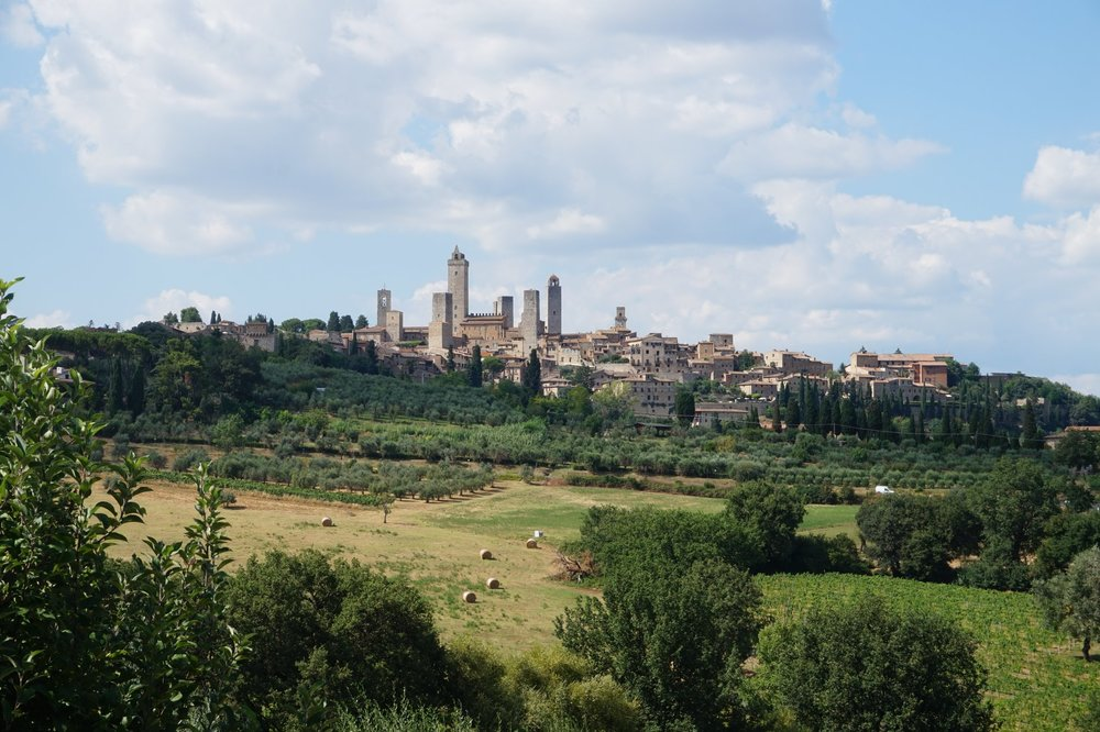 italy tuscany explore san gimignano walk travel trek hike honeymoon views wine vines vineyard