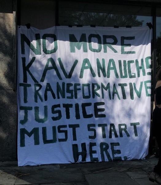 Organizing for Survivors' banner outside Kohlberg.
