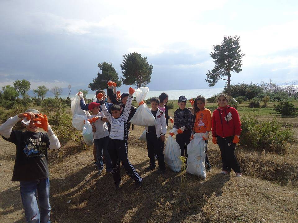 Children in the village of Vardenis clean up the garbage in their local vicinities with AEN's initiative in 2014