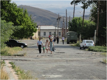 """Not all of Armenia's villages are """"natural""""; that is, some were the result of politically-driven relocations during Soviet times, notwithstanding the availability of critical natural resources, such as drinking water. Although factories and businesses once abounded in many of these areas, and poverty was not as rampant as it is now, water pipes were never constructed for those living there. The Armavir region is home to several of these kinds of villages, which continue to receive weekly rations of water by truck as they did when they were first established under the Soviet system. Photo courtesy of Kirk Wallace."""