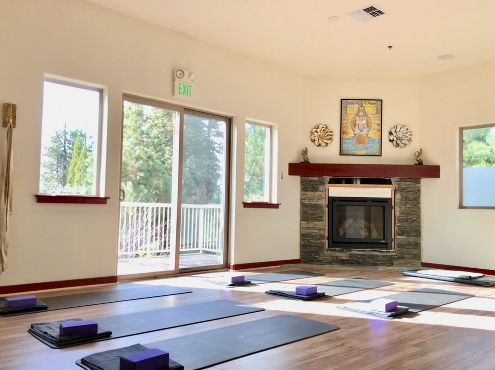 Yoga Room Open and bright with sliding glass door, deck, and fireplace -