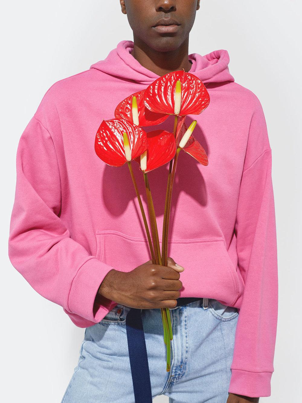 Travis Wears One DNA Oversized Hoodie in Pink