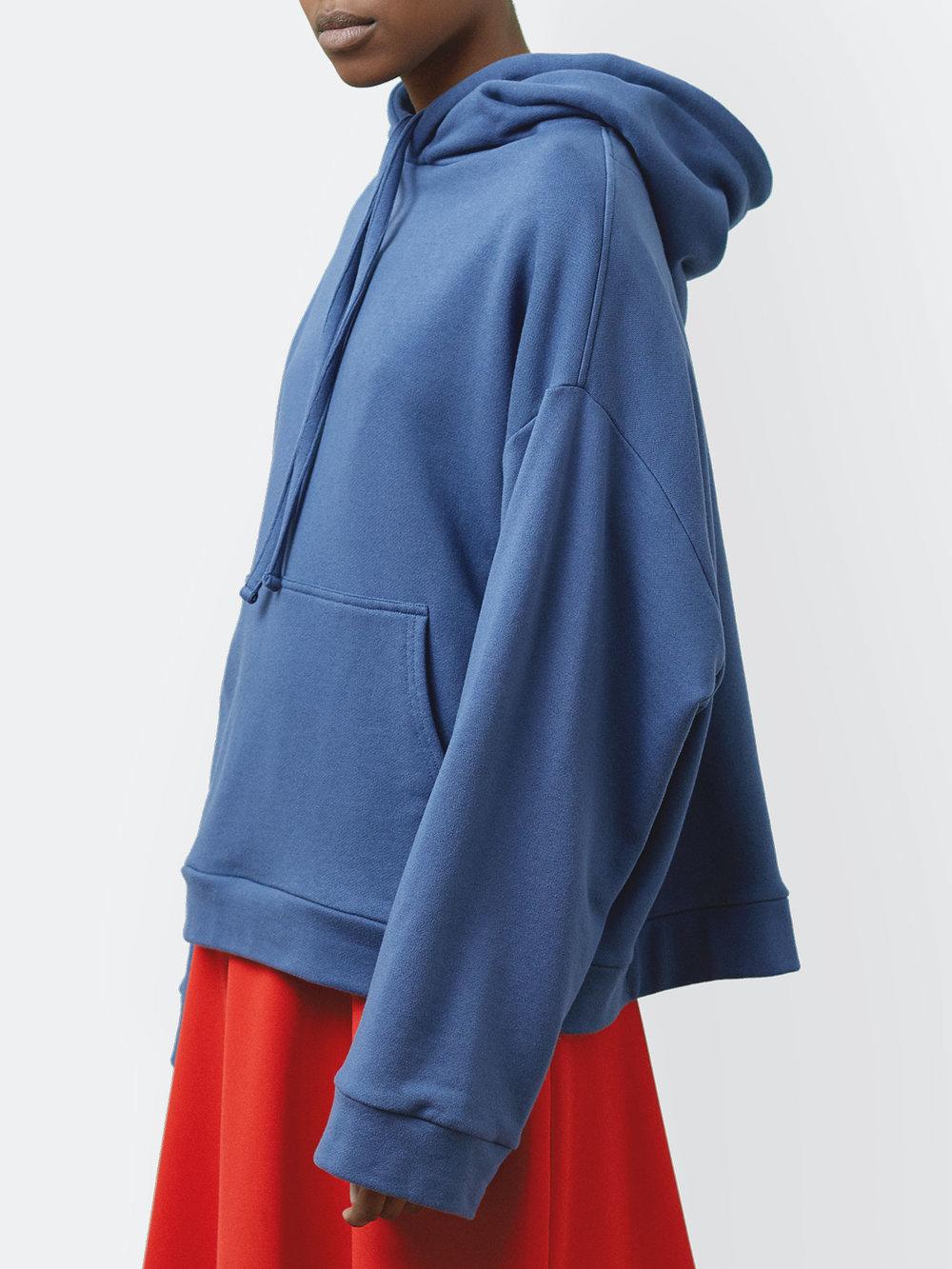 Kemi Wears One DNA Oversized Hoodie in Blue Jean