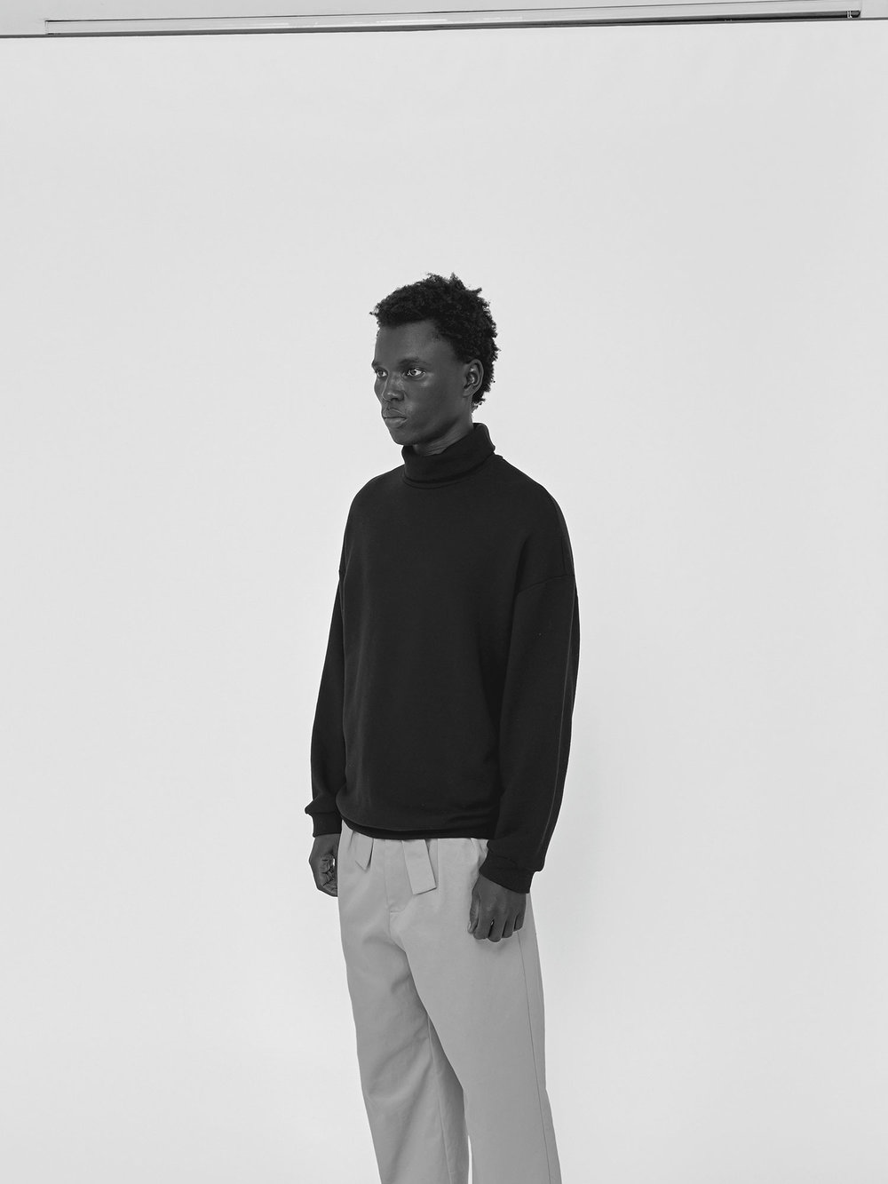 George wears turtleneck and paperbag-waist pant, available now at FABRIC in Auckland.