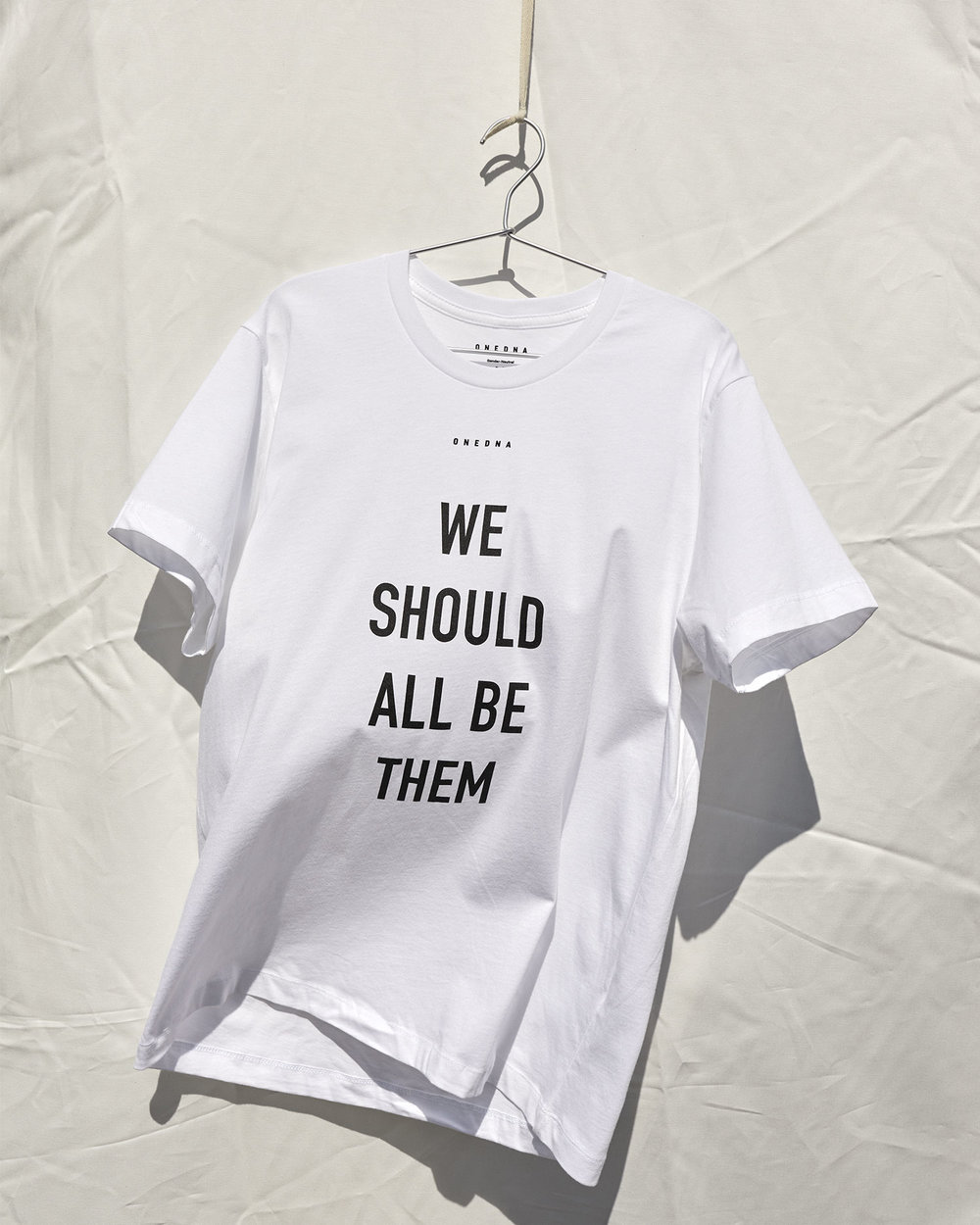 Shop The Official We Should All Be Them T-shirt Online At One DNA's Website.