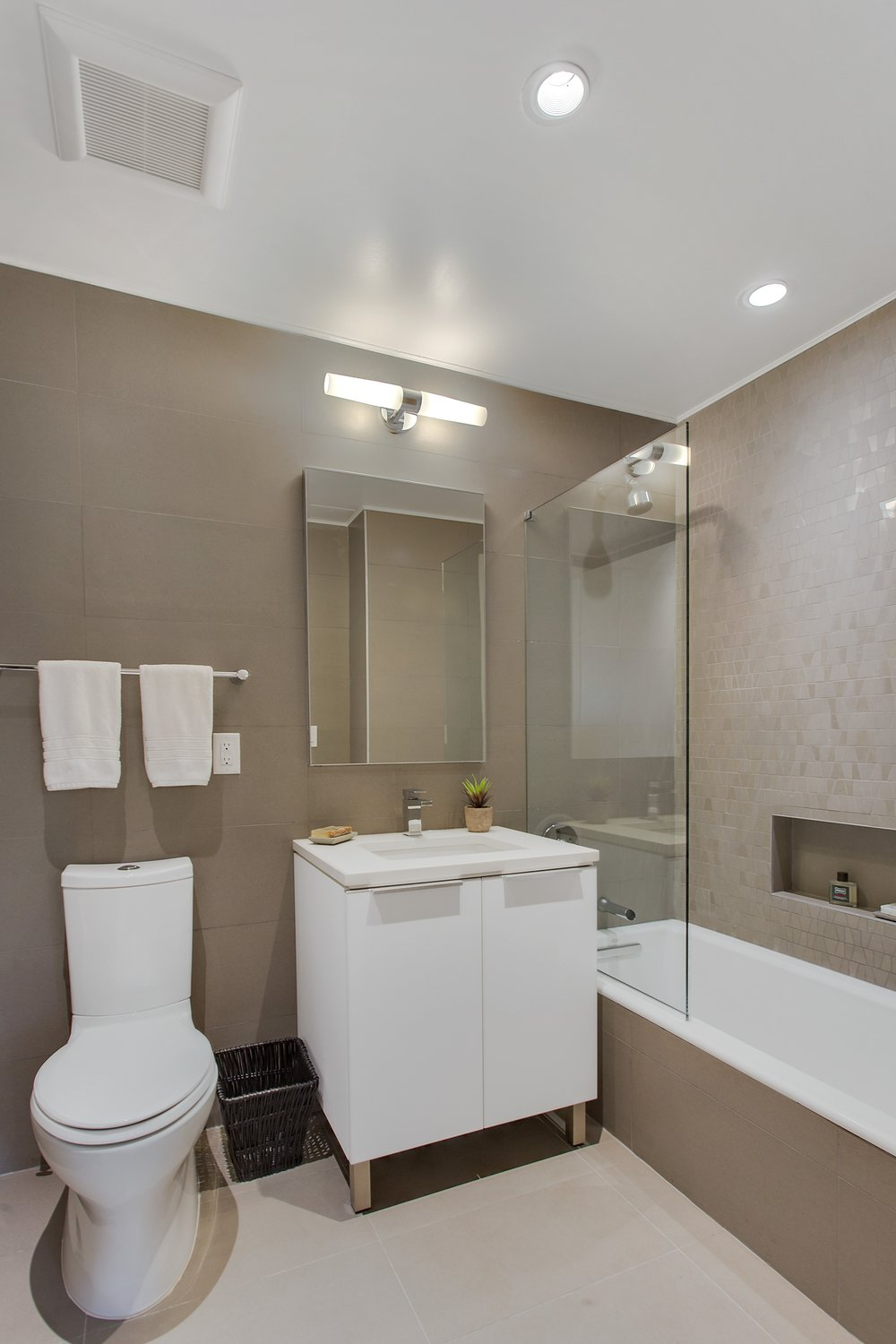 THE BATHROOMS - Bathrooms are outfitted with porcelain tile, a mosaic accent wall, radiant heated floors, Kohler toilets, sinks and bathtubs, along with Kohler shower fixtures.