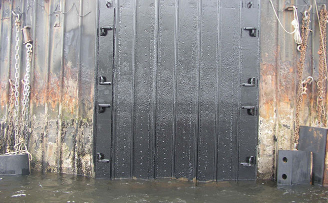 Different areas of corrosion are shown on an older port fender system.