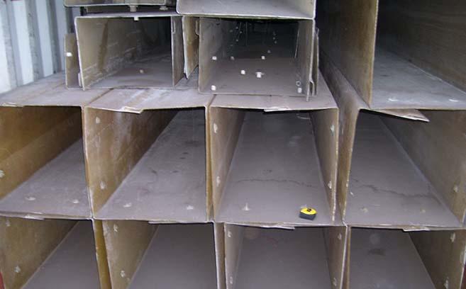 Fiberglass jackets await prep work before installation at shipping port.