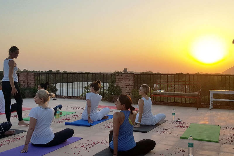 flow-yoga-teacher-training-pushkar-india-rooftop-class.jpg