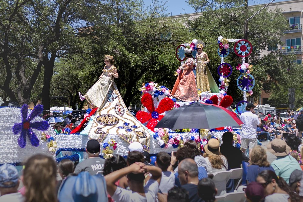 "Years ago, the royal court began to wear comfortable shoes while riding in the Battle of Flowers Parade.  Thus began the tradition of ""Show me your shoes!"" Each year the shoes get more unique and embellished to the point that the shoes are just as loved as the dresses."