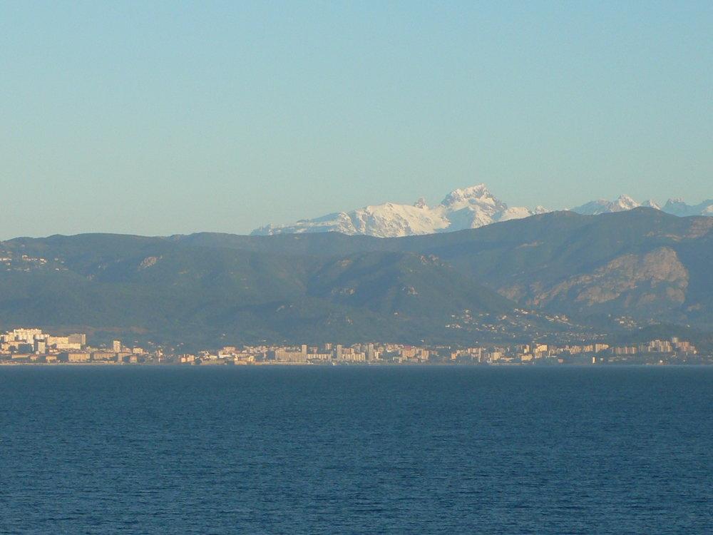 Snow covered peaks above Ajaccio in April
