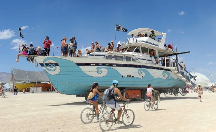 @meganfr3sh at the front of the yacht at Burning Man