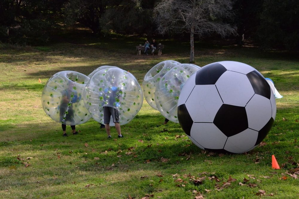 Bubble Soccer Rental - Bubble Ball Soccer Players Delegating Before Game