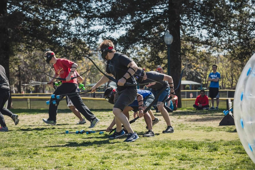 Players run to the middle to obtain Arrows | Archery Tag by AirballingLA