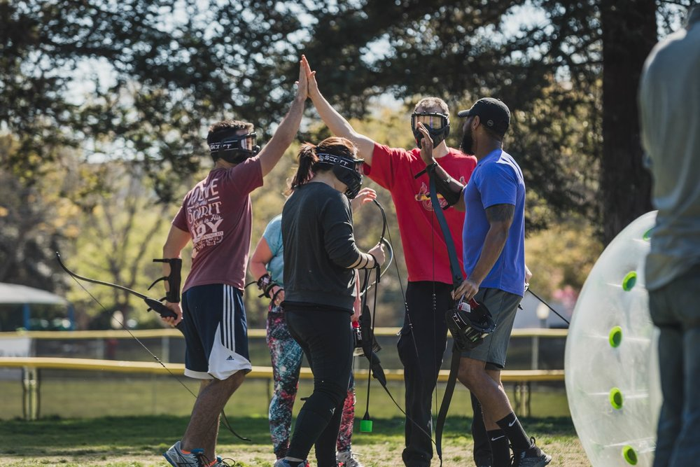 Winner's High Five after a Round of Archery Tag .jpg