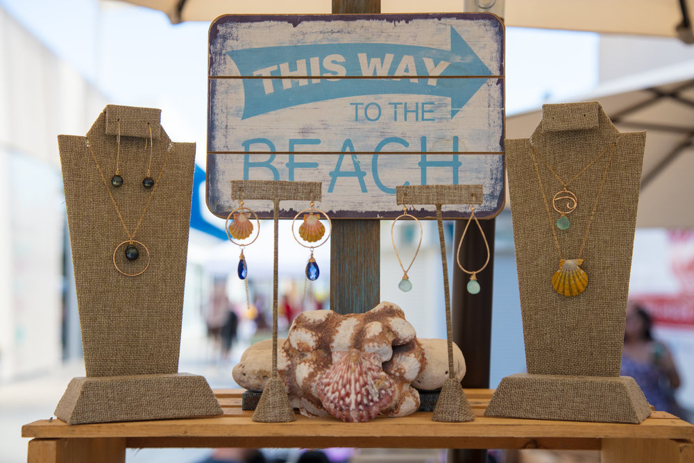 jewelry display of sunrise shells and pearl earrings and necklaces.jpg