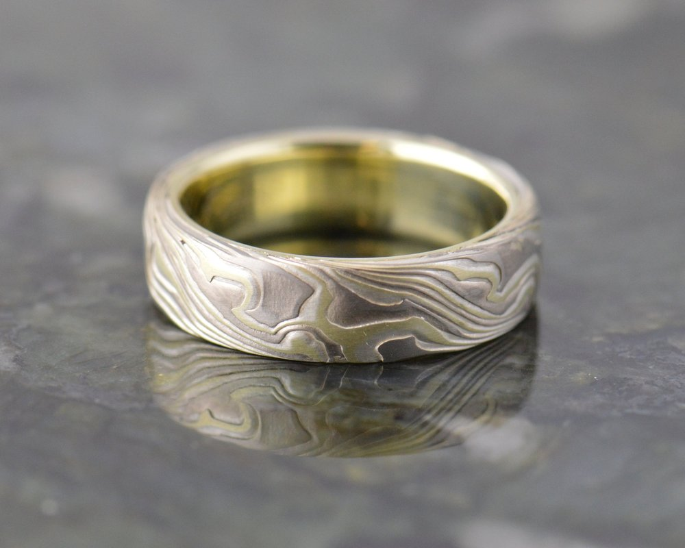 Simplicity found with a burl pattern over solid 14k green gold. Green gold is a thing...