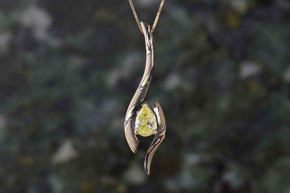 darvier-yellow-diamond-pear-18k-shakudo-pendant.jpg