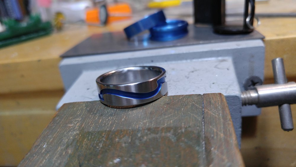 darvier-blue-anodized-titanium-wave-ring.jpg