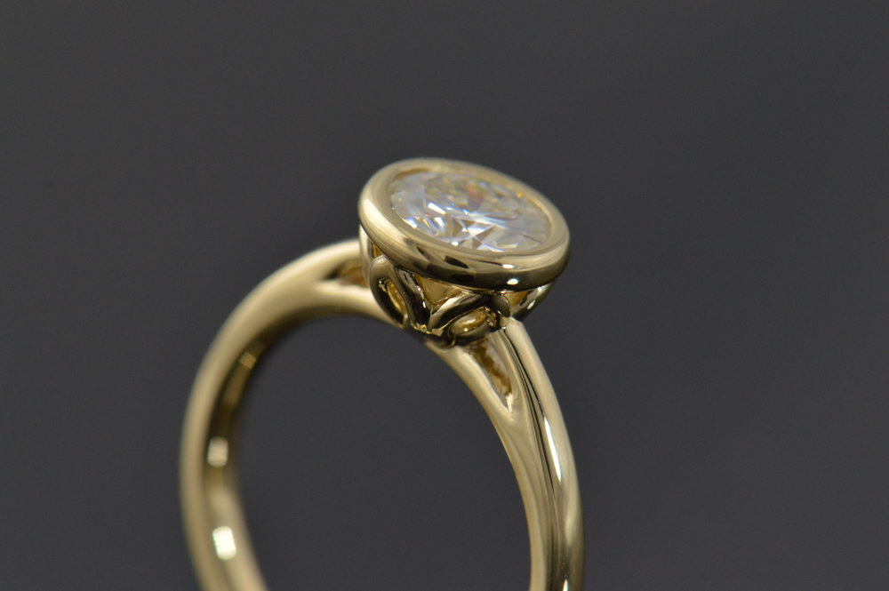 darvier-gold-gallery-bezel-Moissanite-ring.JPG