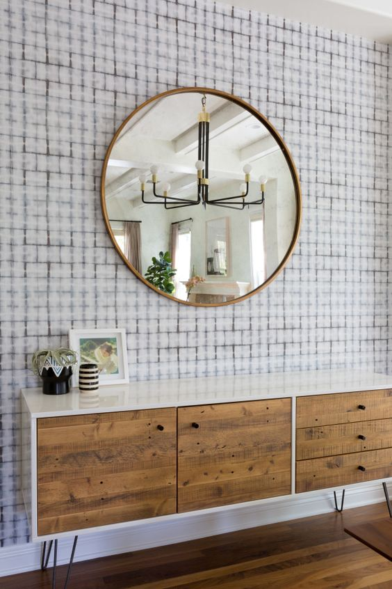 Heres a more muted option. It still has plenty of global influence, but is more subdued than the two examples above it. The subtle colors of the wallpaper allow the wood elements of the room to shine through.   Photo Credit: Style Me Pretty