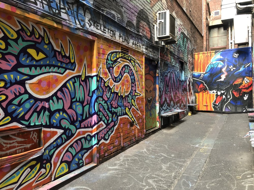 Photo by Lou Chamberlin in Croft Alley, Melbourne CBD, July 2018. Painting by Facter at left and Keomatch at the end of the lane.