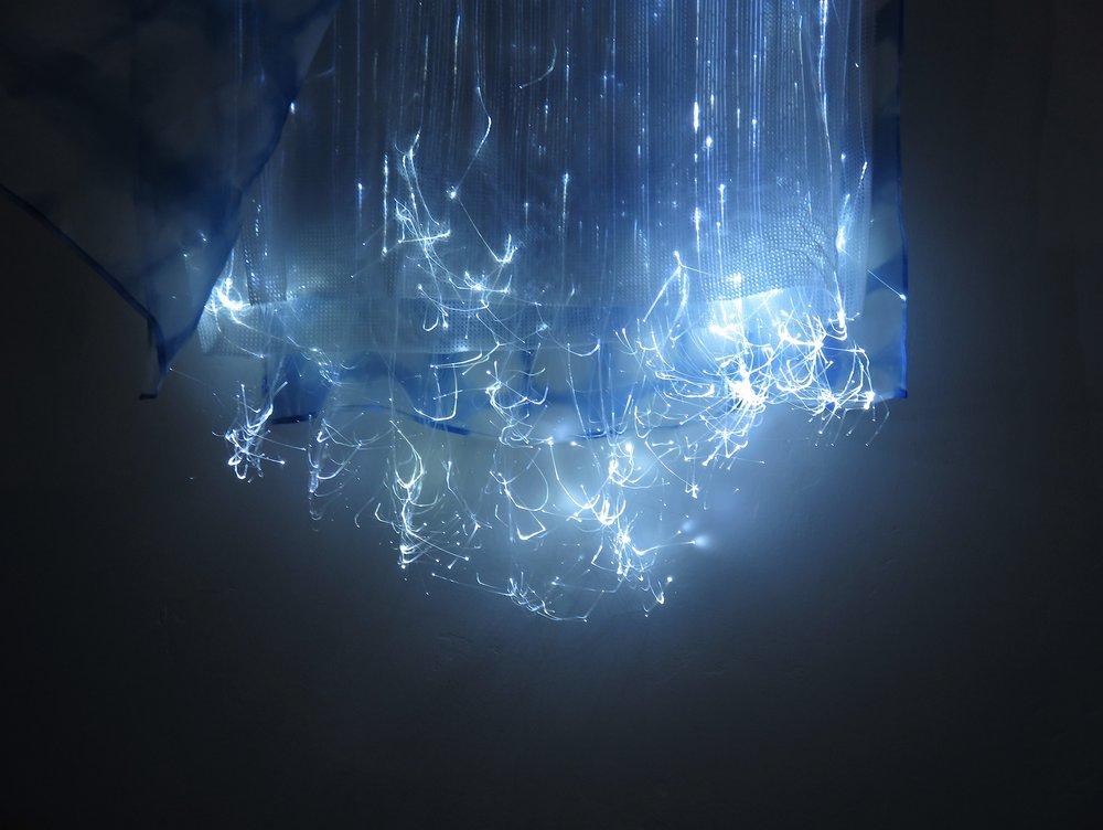 A nebula of light glows on Starlight's hem