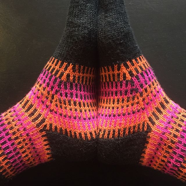 Introducing Ajao. This colour work sock pattern is now available as a free download on Ravelry (link in bio) or via @knotionsmag . My (almost neon pink) sample socks brighten my day no end, peeking out from under my usual all black outfit! . . . #sockknitting #sockknittersofinstagram #handknitting #knittersofinstagram #slowfashion #designdevelopment #patternwriting #neon #dpnlove #langyarns #knotionsmag #yarnpeoplearethebestpeople