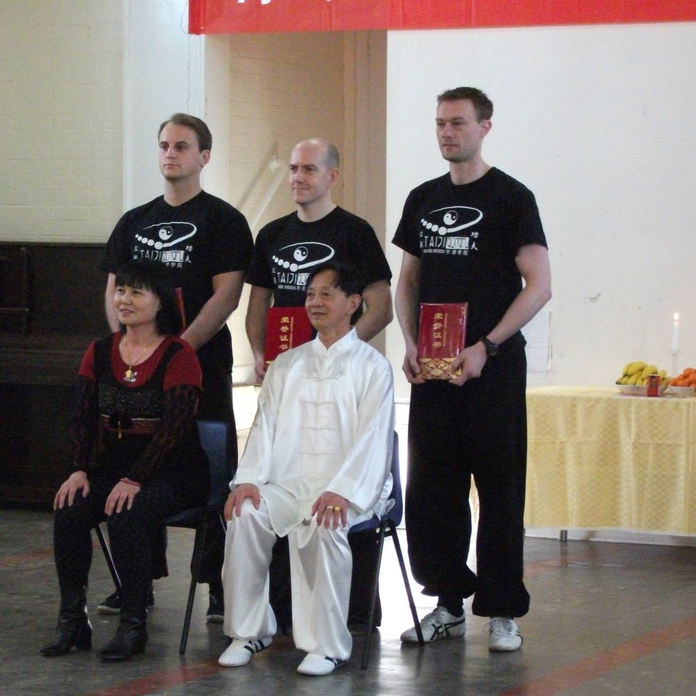 Paul Lockyer's (in the middle) Bai Shi ceremony in March 2012 Paul is pictured with two of Grandmaster Gou's disciples, Douglas (left) and Adrian (right)