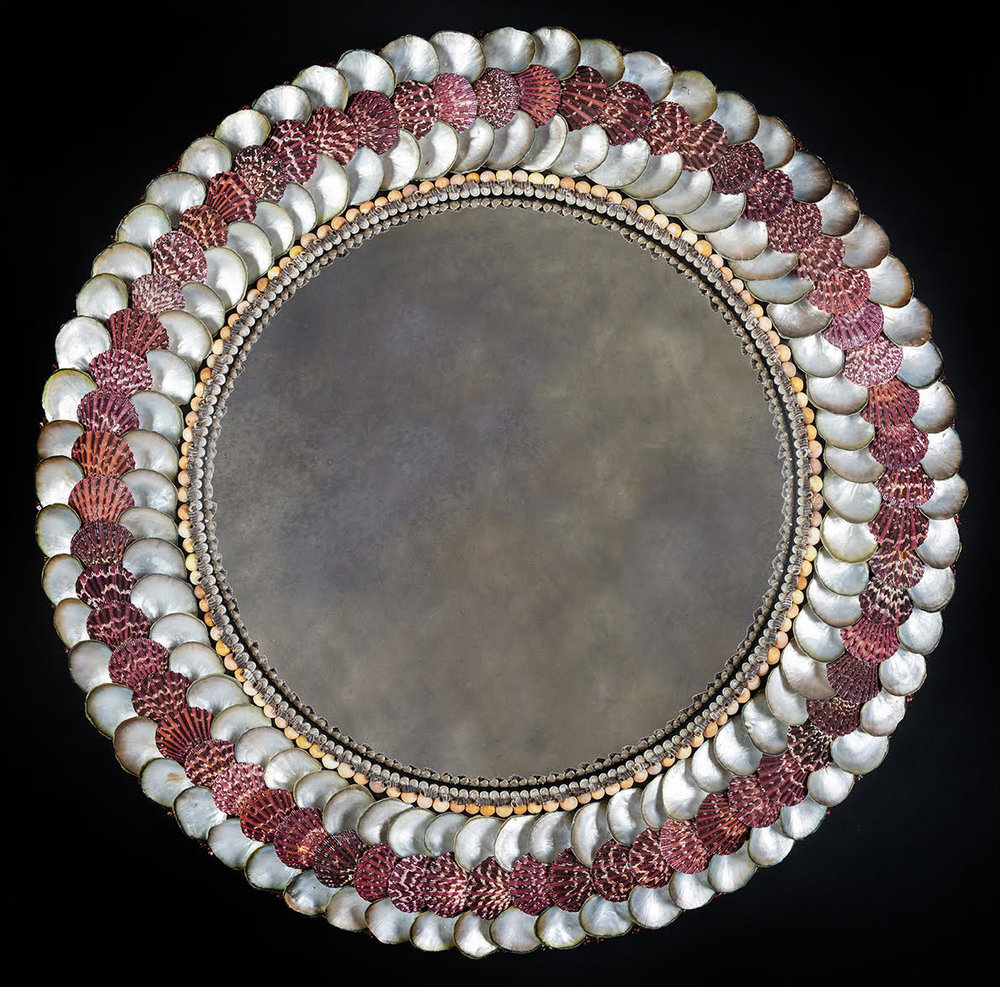 Convex Mirror with Red Scallop shells   A convex shell mirror with Cloak Scallop shells and mother of pearl oysters.Diameter 76 cm