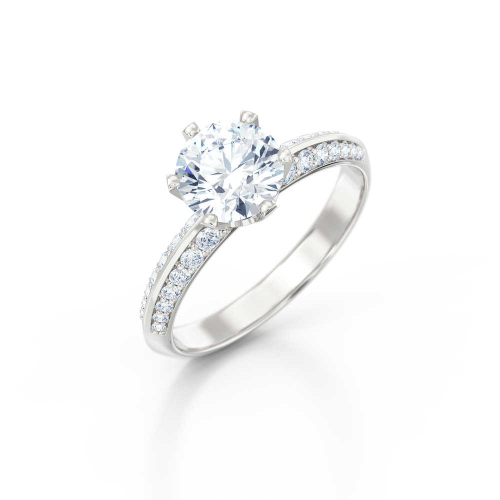 Brilliant cut knife edge diamond shoulder engagement ring