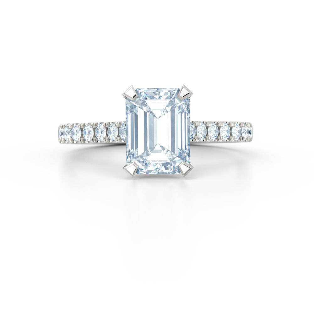 Emerald cut diamond shoulder engagement ring