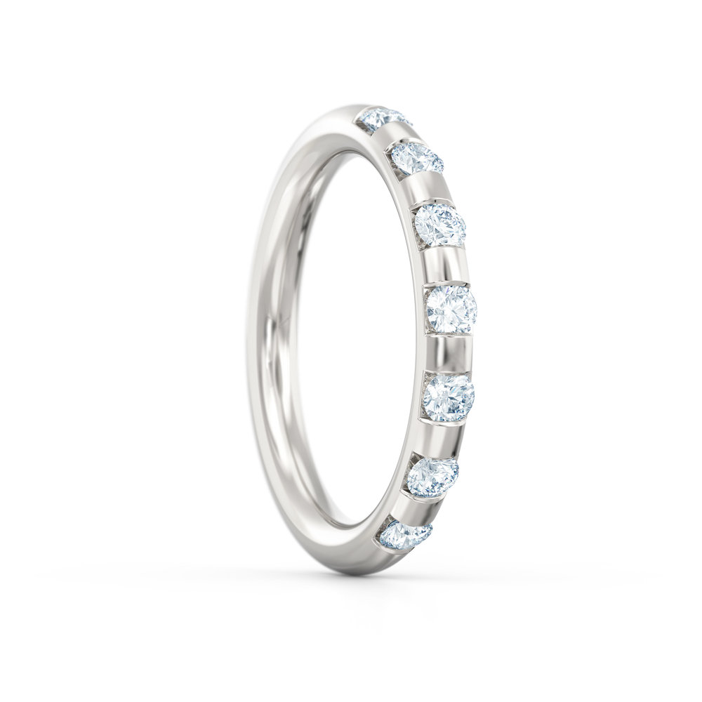 Brilliant cut off-set diamond eternity ring