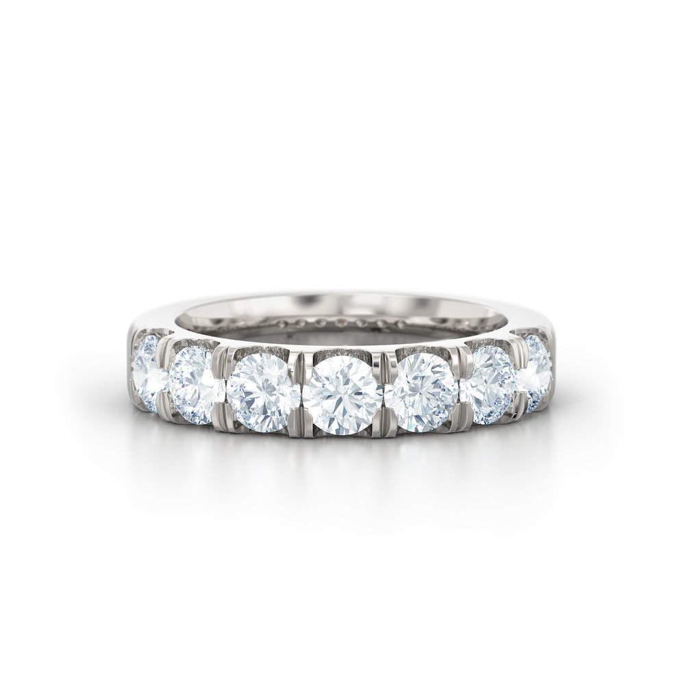 Brilliant cut split claw eternity ring