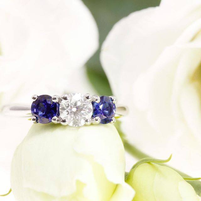 A trilogy engagement ring, exclusively designed for one of our most recent clients. Ceylon sapphires shouldering a brilliant cut diamond on a platinum shank. All our rings come with complimentary engraving and aftercare package, find out more at http://www.lovefinediamonds.co.uk  #jewellers #hattongarden #london #wedding #weddinginspiration #weddingrings #engagementrings #weddingbands #photooftheday #love #jewelry #jewellery #handmadejewelry #engagementring #fashion