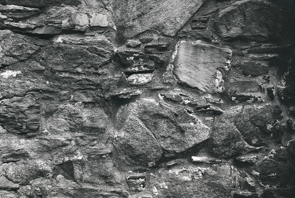Additional image, no. 3: photo of mediveal stone wall, where Håkonshallen stands today, Bergen.   Analogue 4x5, b/w photograph.